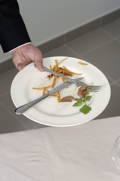 Waiter clearing plates